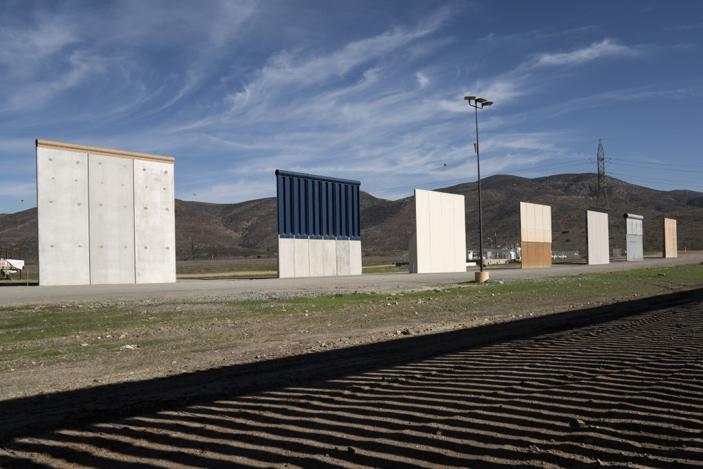 Border wall prototypes stand in San Diego near the Mexico U.S. border, seen from Tijuana, Saturday, Dec. 22, 2018. The U.S. federal government remains