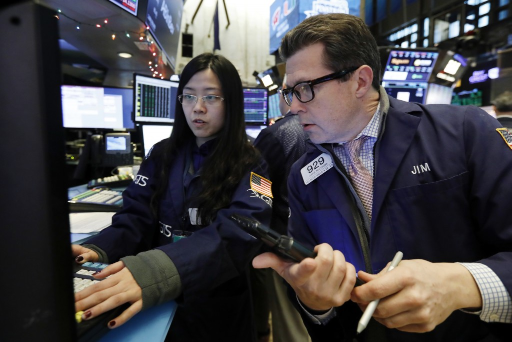 Specialist Vera Liu, left, and trader James Matthews work on the floor of the New York Stock Exchange, Wednesday, Dec. 26, 2018. Stocks are opening hi...