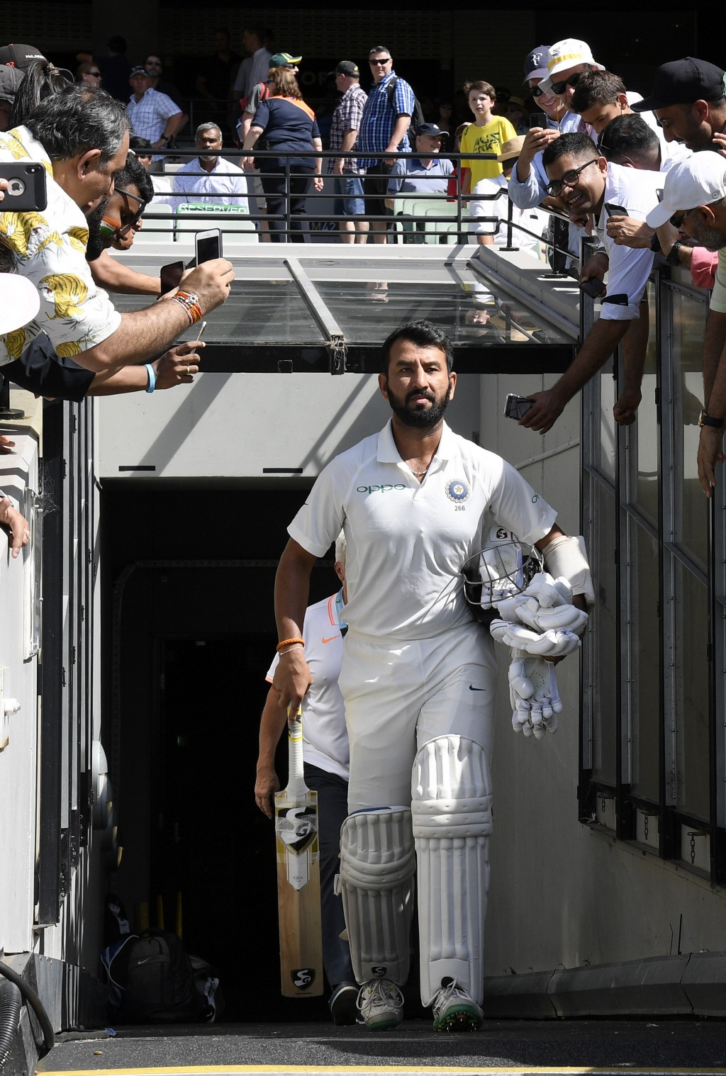 India's Cheteshwar Pujara enters the field before play on day two of the third cricket test between India and Australia in Melbourne, Australia, Thurs...