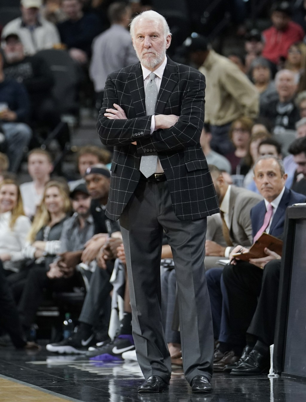 San Antonio Spurs coach Gregg Popovich watches play during the second half of the team's NBA basketball game against the Denver Nuggets, Wednesday, De...
