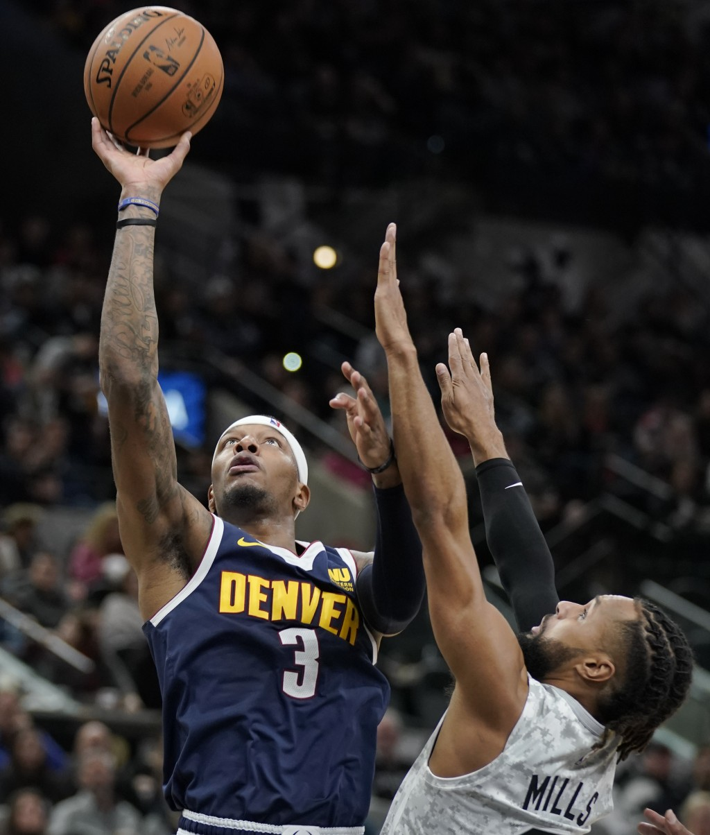 Denver Nuggets' Torrey Craig (3) shoots against San Antonio Spurs' Patty Mills during the first half of an NBA basketball game, Wednesday, Dec. 26, 20...