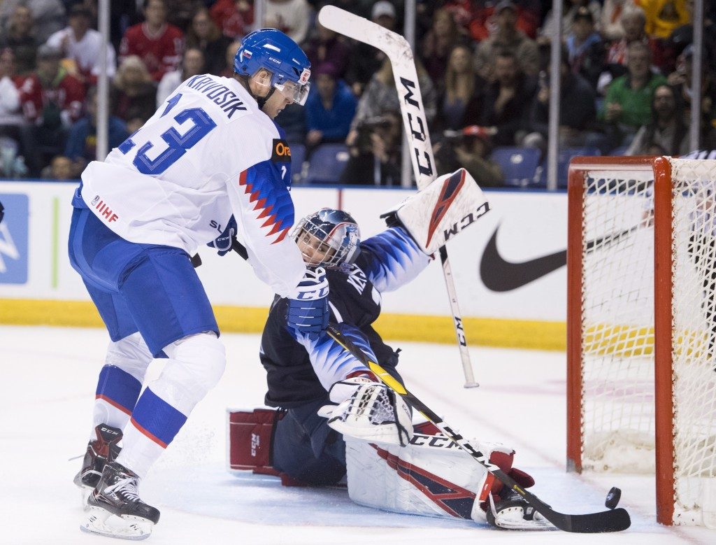U.S. goaltender Kyle Keyser stops a shot from Slovakia's Adam Ziska during the first period in a world junior men's hockey championship game in Vancou...