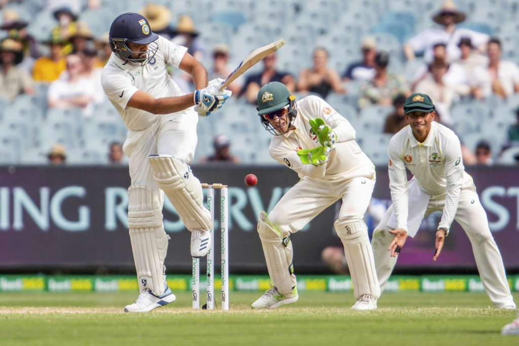 India's Rohit Sharma bats during a play on day two of the third cricket test between India and Australia in Melbourne, Australia, Thursday, Dec. 27, 2...