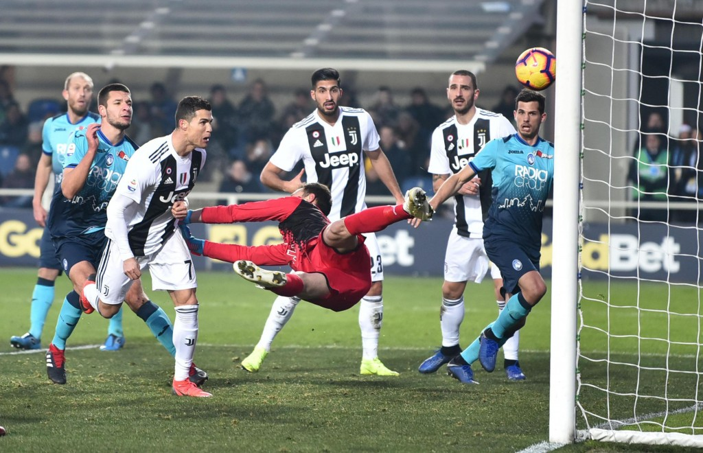 Juventus' Cristiano Ronaldo, third from left, scores his side's second goal during the Serie A soccer match between Atalanta and Juventus in Bergamo, ...