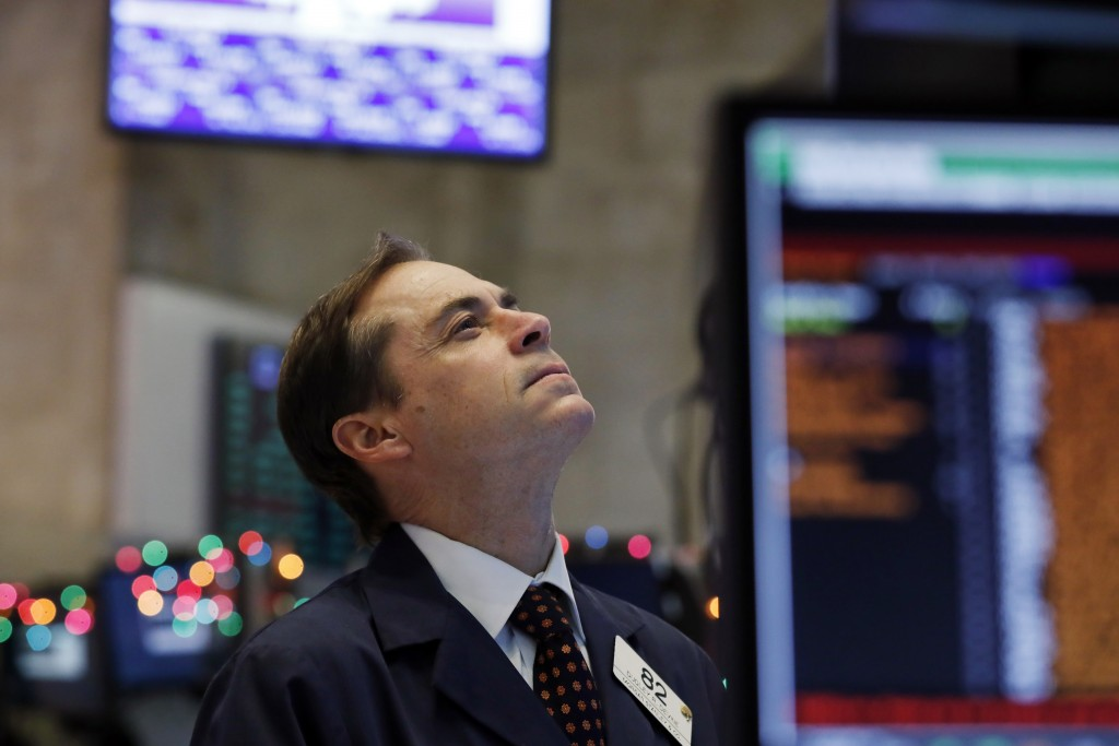 Trader Dudley Devine works on the floor of the New York Stock Exchange, Wednesday, Dec. 26, 2018. Stocks are opening strongly higher on Wall Street We...