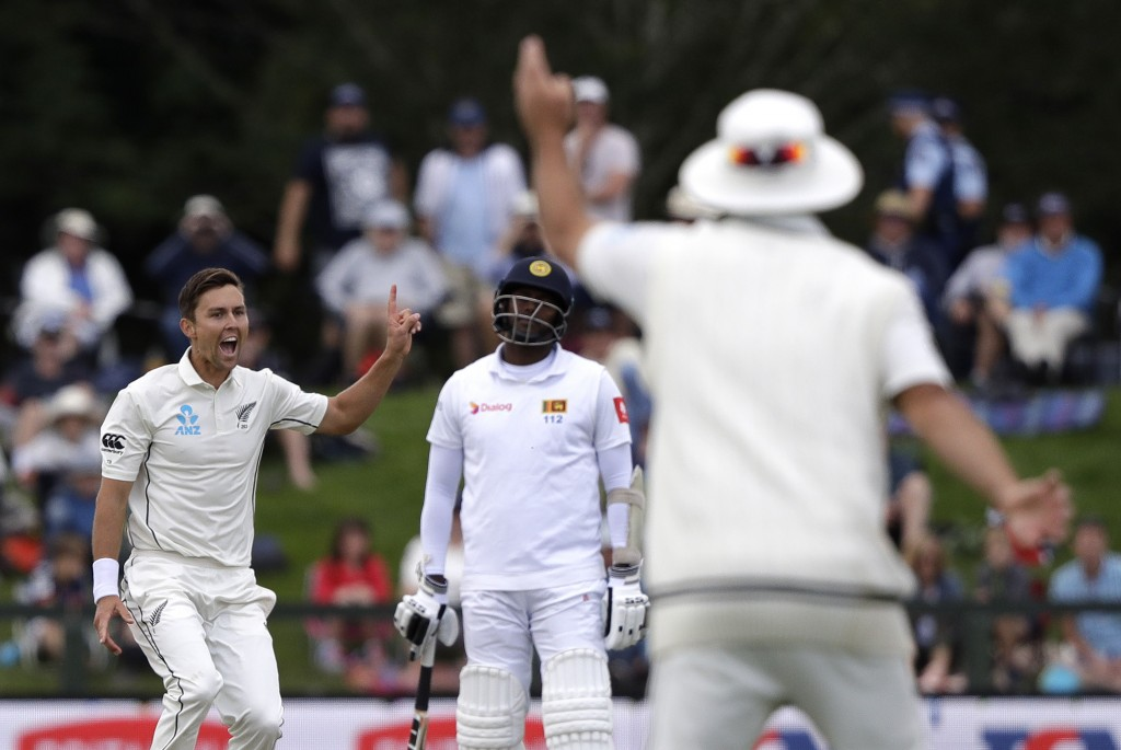 New Zealand's Trent Boult appeals successfully for the wicket of Sri Lanka's Lahiru Kumara during play on day two of the second cricket test between N