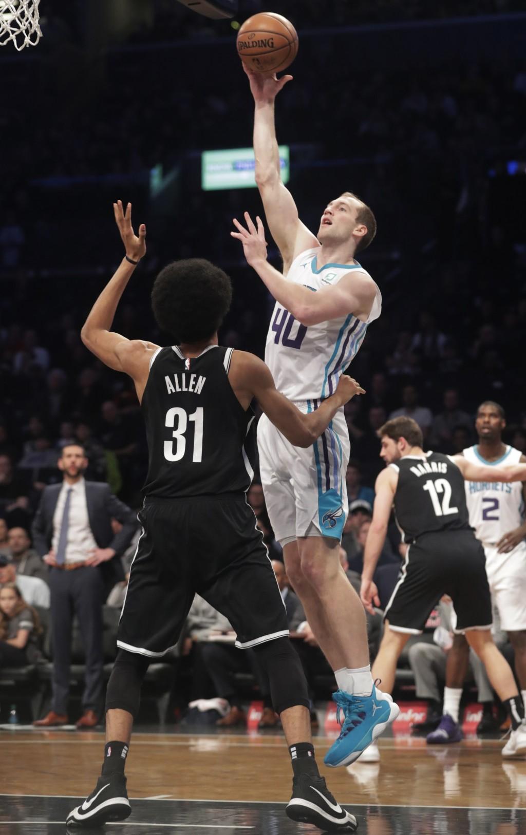 Charlotte Hornets' Cody Zeller (40) shoots over Brooklyn Nets' Jarrett Allen (31) during the first half of an NBA basketball game Wednesday, Dec. 26, ...