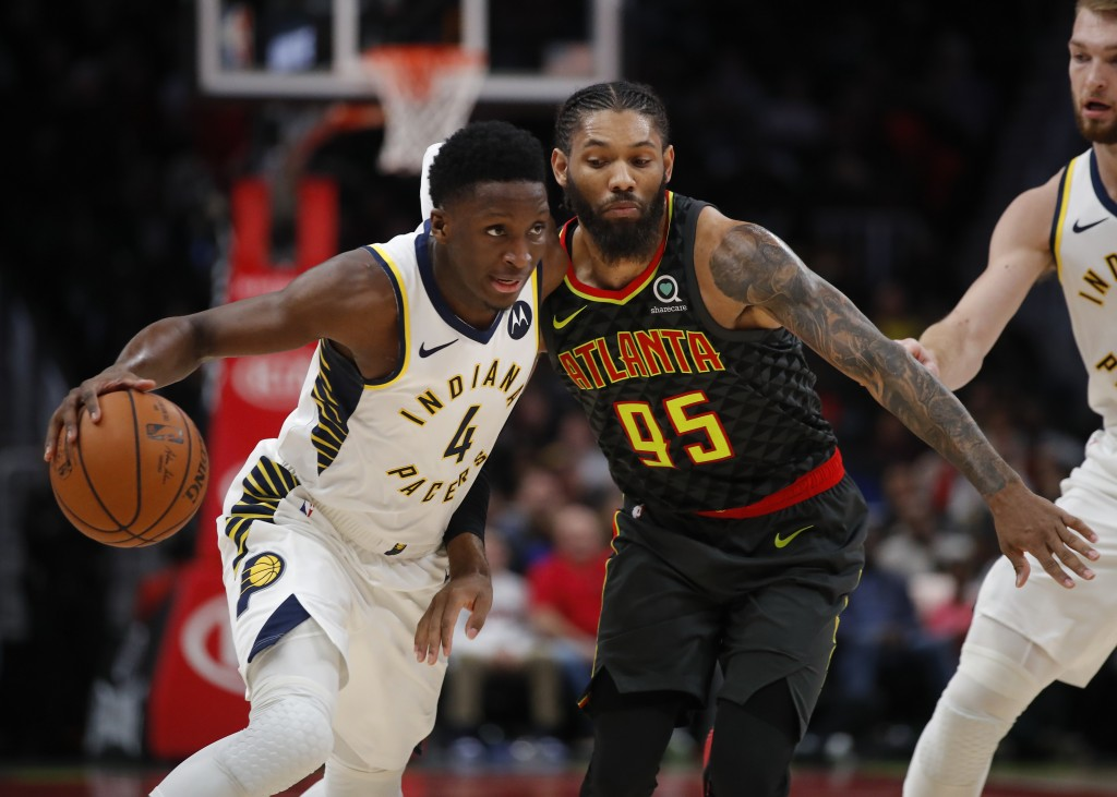 Indiana Pacers guard Victor Oladipo (4) drives to the basket as Atlanta Hawks forward DeAndre' Bembry (95) defends during the second half of an NBA ba...