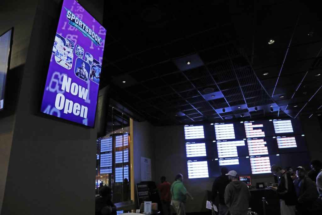 "In this Dec. 18, 2018 photo, a ""Now Open"" sign is displayed at the Pearl River Resort in Philadelphia, Miss. The sports book owned by the Mississippi ..."