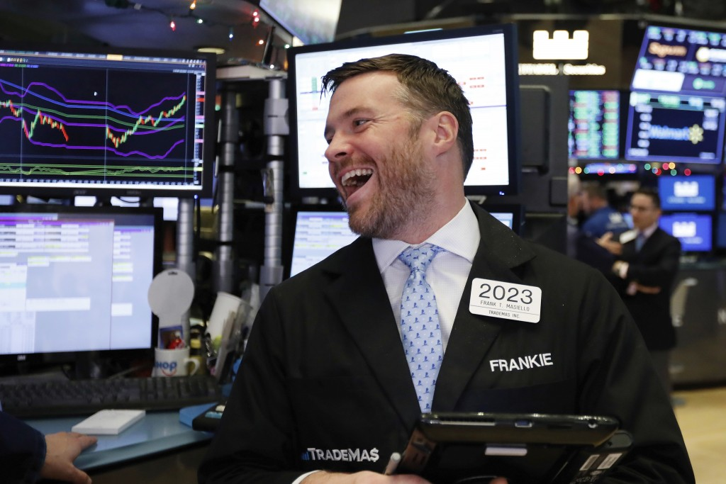 Trader Frank Masiello smiles as he works on the floor of the New York Stock Exchange before the closing bell, Wednesday, Dec. 26, 2018. The Dow closed...