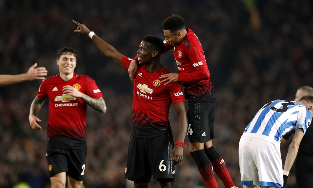 Manchester United's Paul Pogba, center, celebrates scoring against Huddersfield during the English Premier League soccer match  at Old Trafford, Manch...