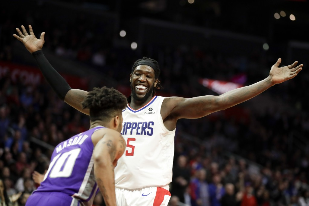 Los Angeles Clippers forward Montrezl Harrell celebrates after blocking a shot by Sacramento Kings guard Frank Mason III during the second half of an ...