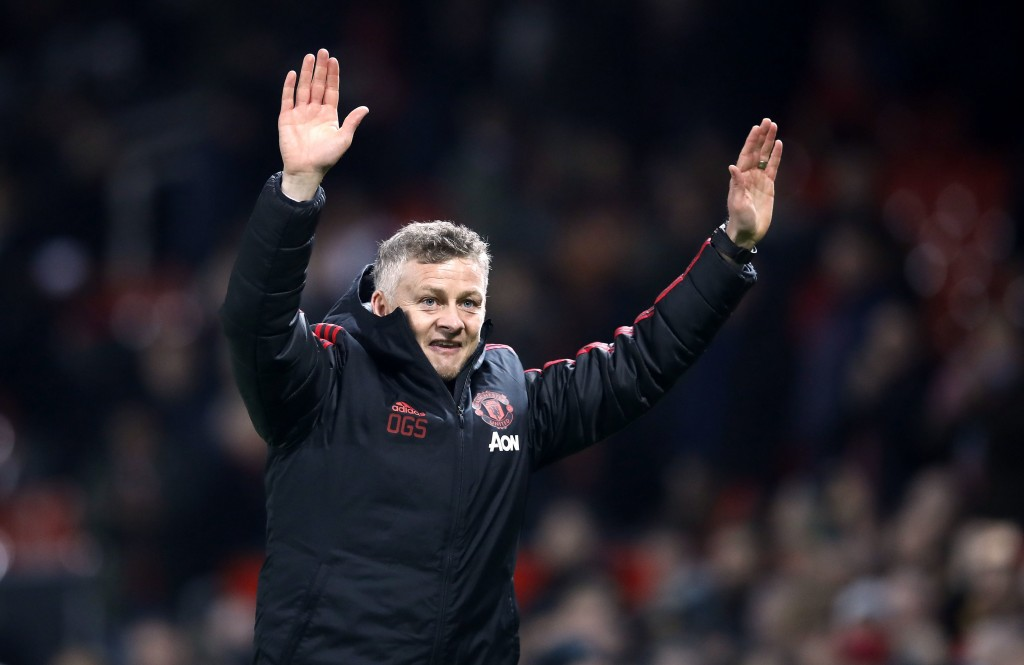 Manchester United interim manager Ole Gunnar Solskjaer celebrates defeating Huddersfield after the English Premier League soccer match  at Old Traffor