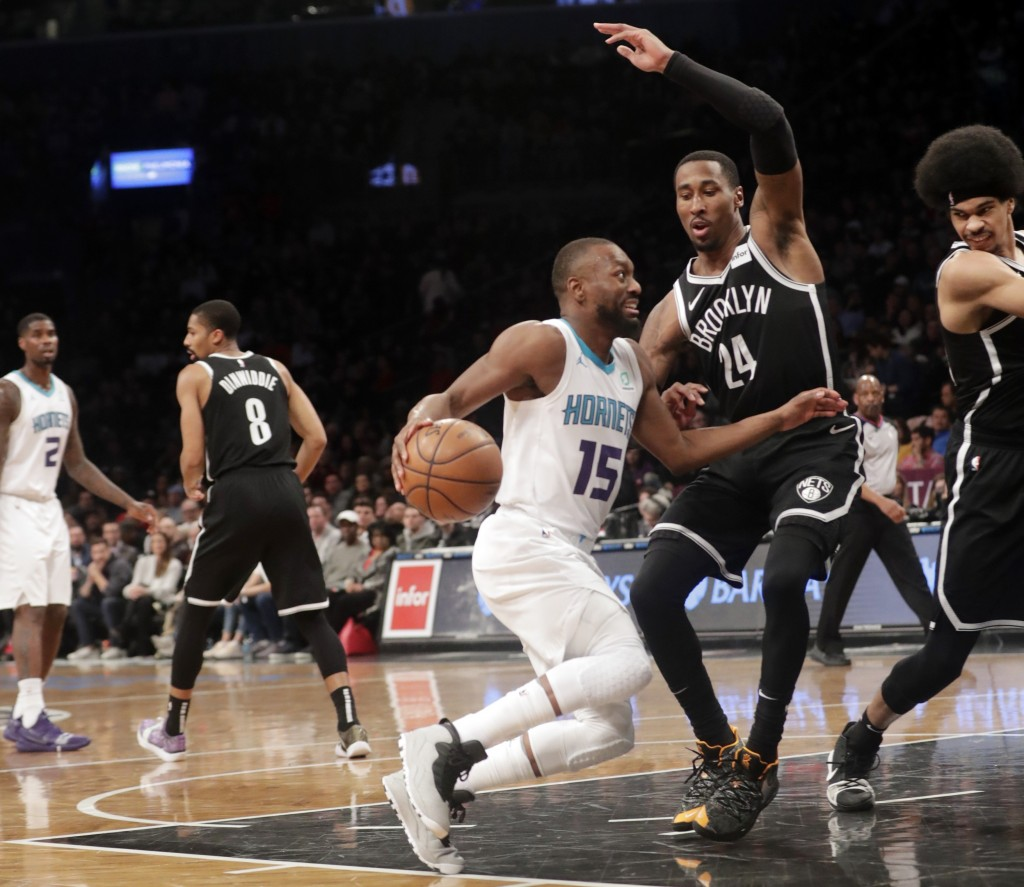 Charlotte Hornets' Kemba Walker (15) drives past Brooklyn Nets' Rondae Hollis-Jefferson (24) during the first half of an NBA basketball game Wednesday...