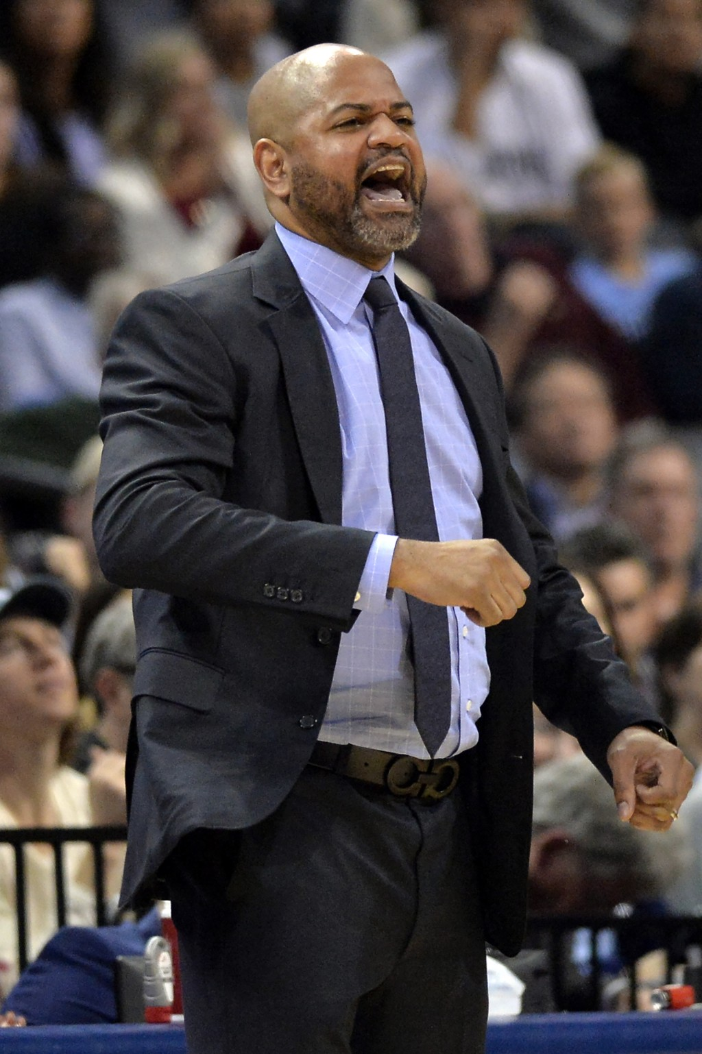 Memphis Grizzlies coach J.B. Bickerstaff calls to players during the second half of an NBA basketball game against the Cleveland Cavaliers on Wednesda...
