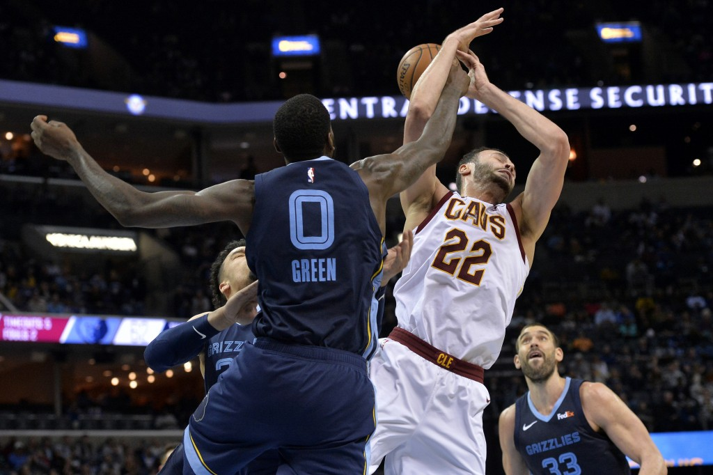 Cleveland Cavaliers forward Larry Nance Jr. (22) and Memphis Grizzlies forward JaMychal Green (0) struggle for control of the ball during the second h...