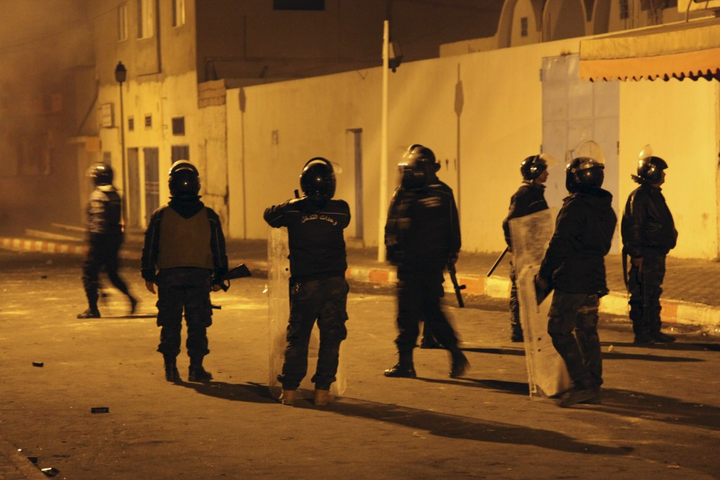 Tunisian Police officers patrol after clashes in the streets of Kasserine, southern of Tunisia, Wednesday, Dec 26, 2018.The death of a Tunisian journa...