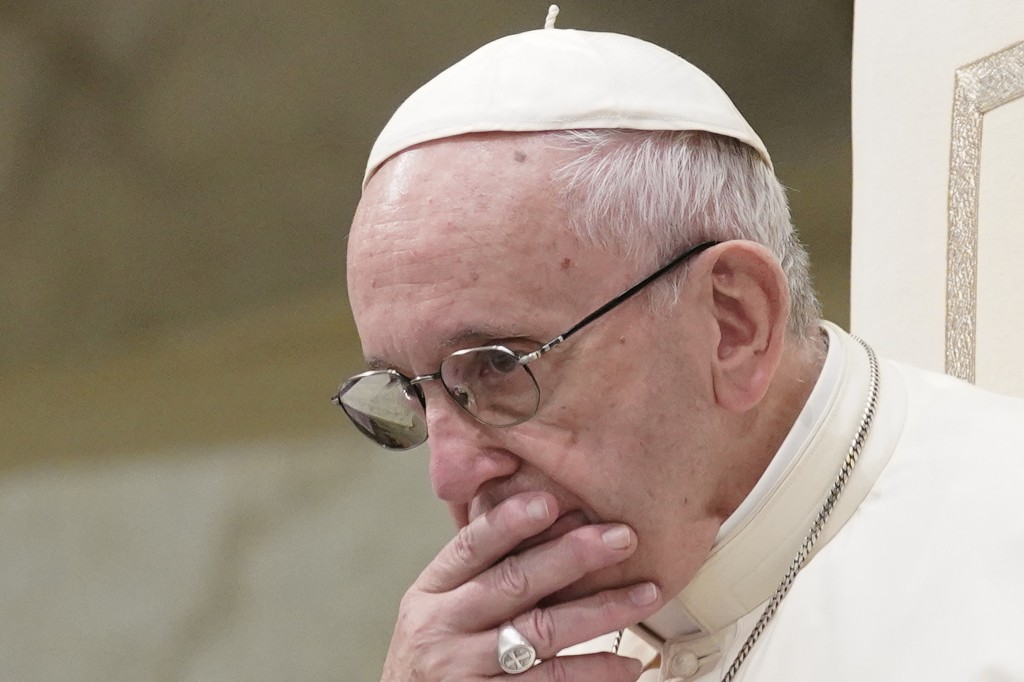 FILE - In this Aug. 22, 2018 file photo, Pope Francis appears during his weekly general audience in the Pope Paul VI hall, at the Vatican. After commi...