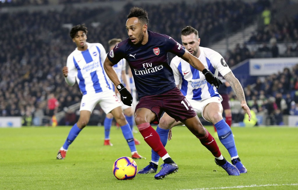 Arsenal's Pierre-Emerick Aubameyang in action during the English Premier League soccer match against Brighton at the AMEX Stadium, Brighton, Wednesday
