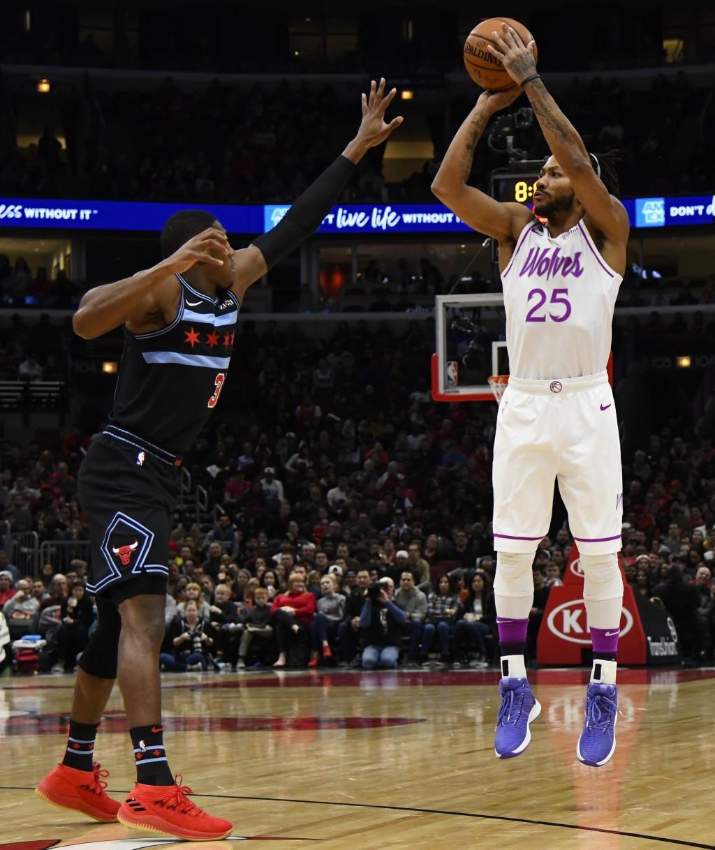Minnesota Timberwolves guard Derrick Rose (25) shoots over Chicago Bulls guard Kris Dunn during the first half of an NBA basketball game Wednesday, De...