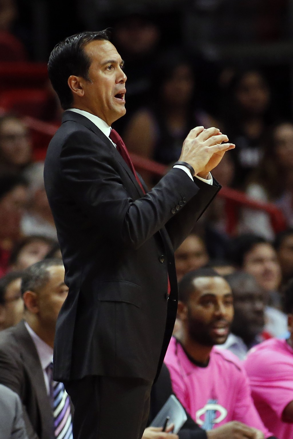Miami Heat head Coach Erik Spoelstra directs the players during the first half of an NBA basketball game against the Toronto Raptors, Wednesday, Dec. ...