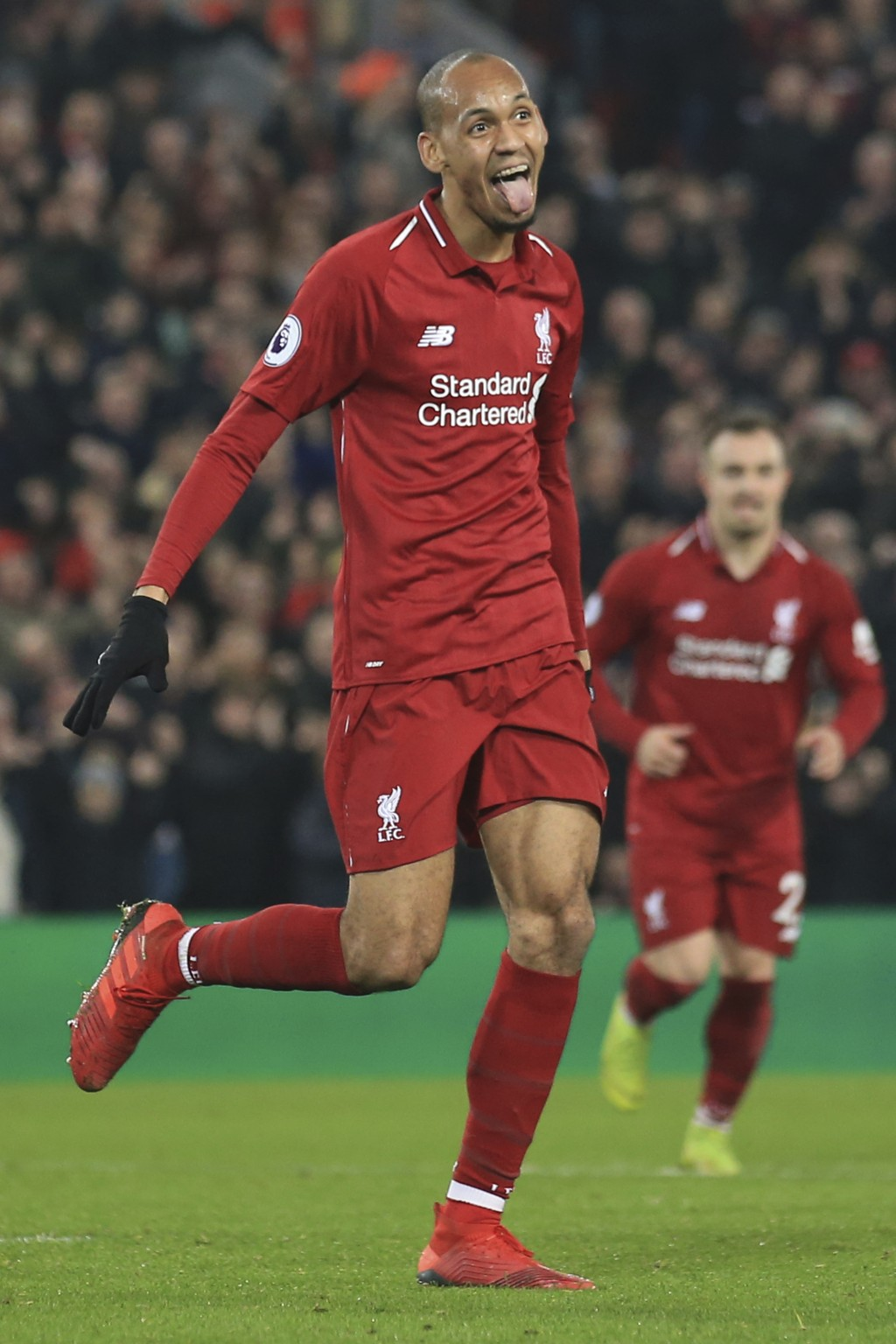 Liverpool's Fabinho celebrates after scoring his side's fourth goal during the English Premier League soccer match between Liverpool and Newcastle at