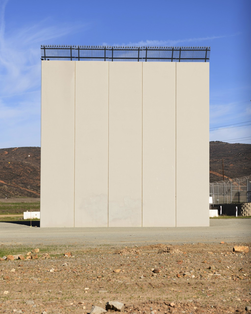 A border wall prototype stands in San Diego near the Mexico-U.S. border, seen from Tijuana, Mexico, Saturday, Dec. 22, 2018. (AP Photo/Daniel Ochoa de