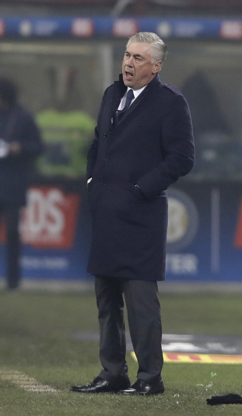 Napoli coach Carlo Ancelotti stands during a Serie A soccer match between Inter Milan and Napoli, at the San Siro stadium in Milan, Italy, Wednesday, ...