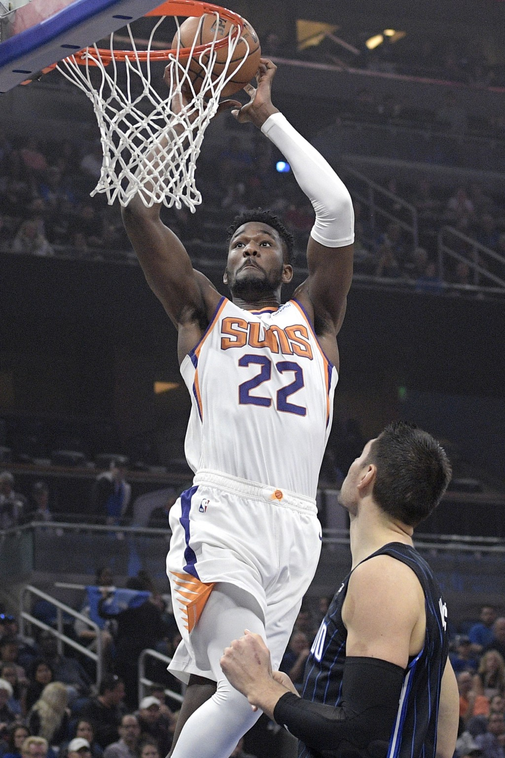 Phoenix Suns center Deandre Ayton (22) dunks in front of Orlando Magic center Nikola Vucevicduring the first half of an NBA basketball game Wednesday,...