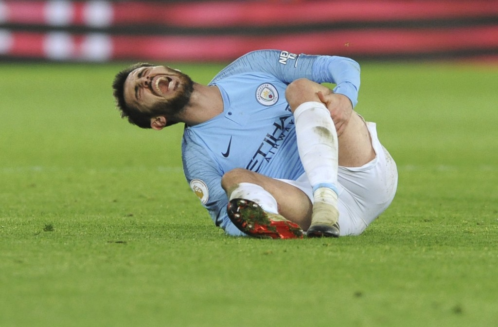 Manchester City's Bernardo Silva lies on the pitch in pain during the English Premier League soccer match between Leicester City and Manchester City a...