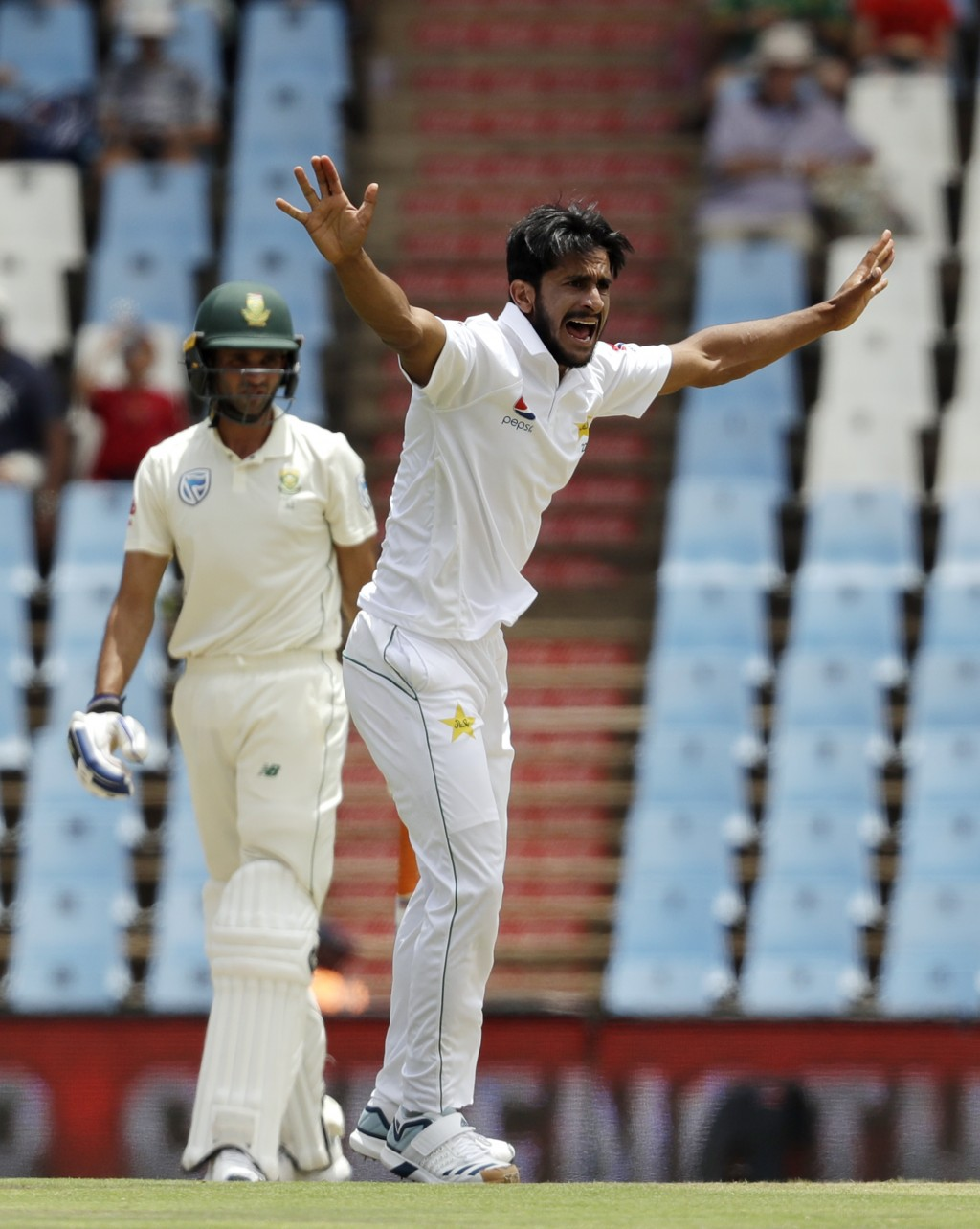 Pakistan's bowler Hasan Ali, right, successfully appeals for LBW against South Africa's batsman Keshav Maharaj on day two of the first cricket test ma...