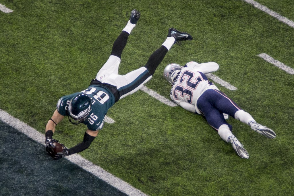 FILE - In this Feb. 4, 2018, file photo, Philadelphia Eagles tight end Zach Ertz (86) dives for a touchdown past New England Patriots safety Devin McC...