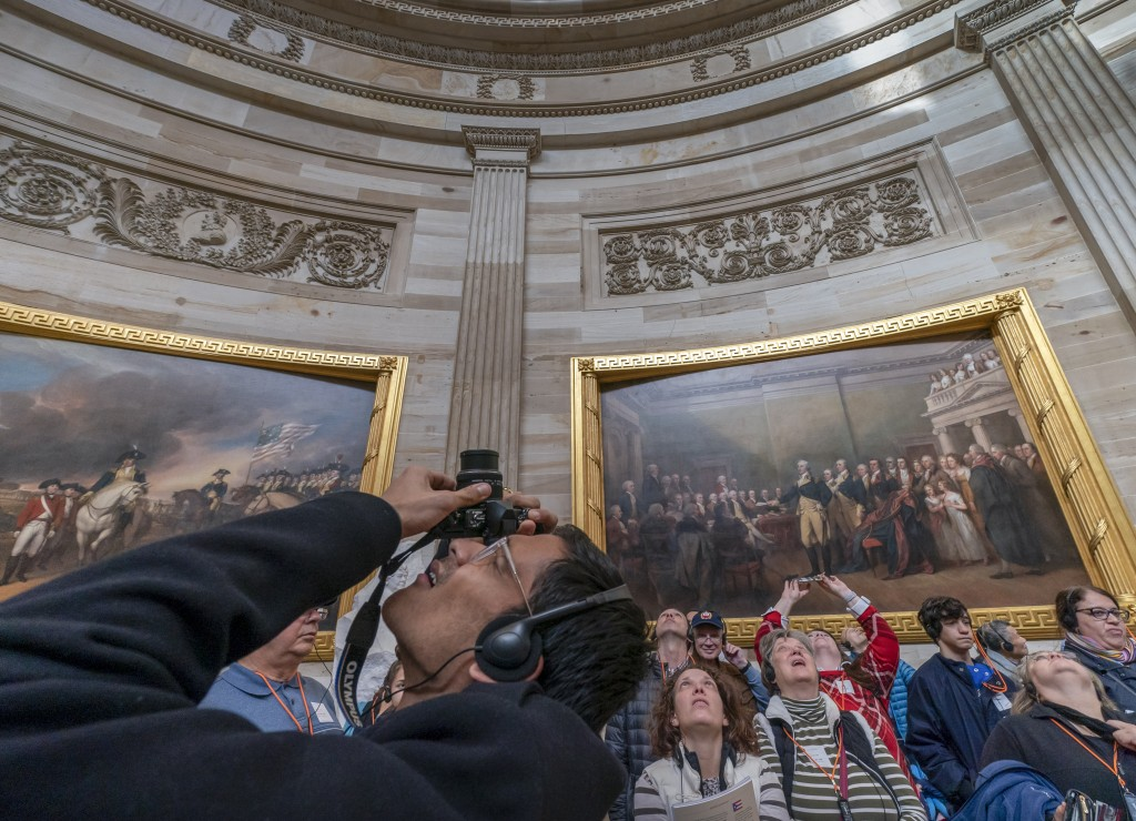 Visitors tour the Capitol Rotunda at the Capitol in Washington, Thursday, Dec. 27, 2018, during a partial government shutdown. Chances look slim for e...