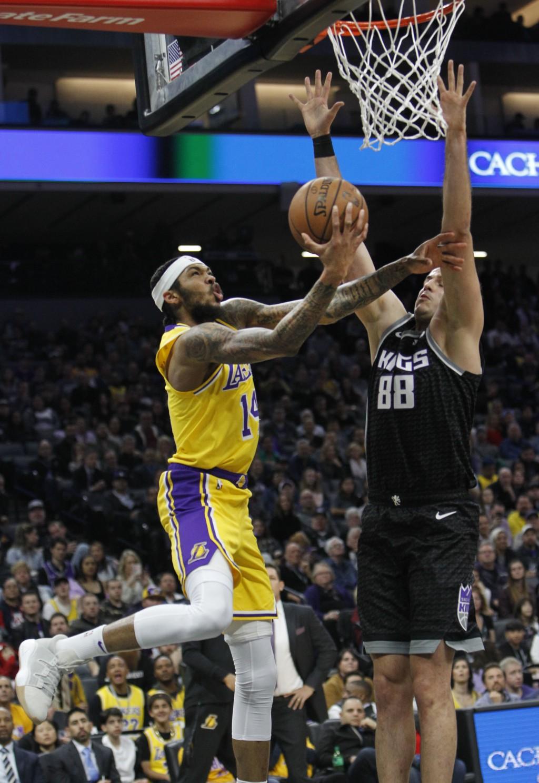 Los Angeles Lakers forward Brandon Ingram (14) shoots as Sacramento Kings forward Nemanja Bjelica (88) defends during the first half of an NBA basketb...