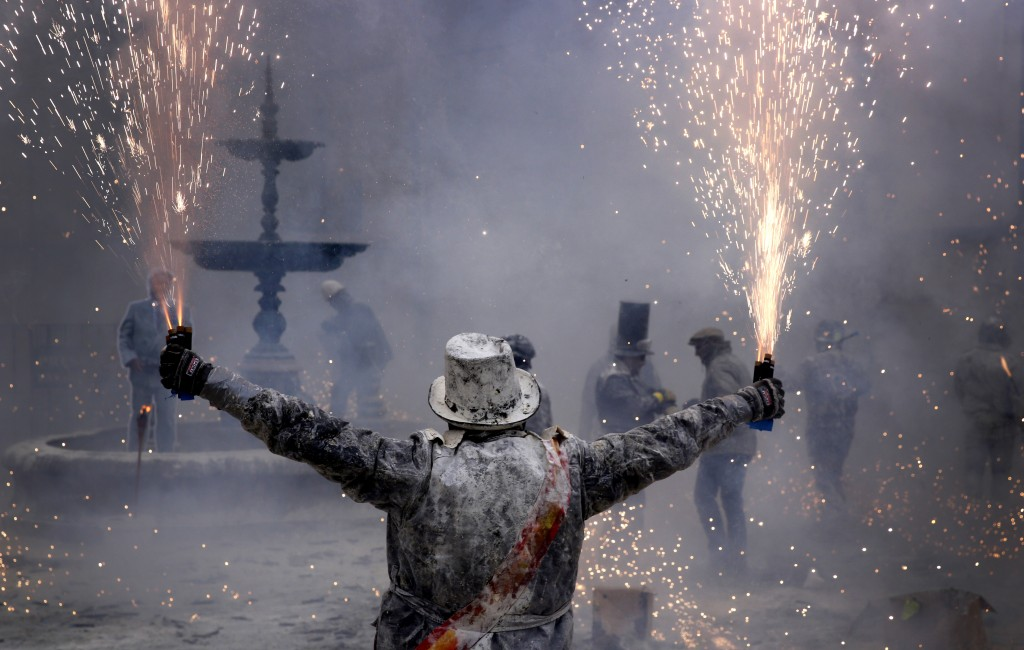 Revellers take part in the festival of Els Enfarinats, in the town of Ibi near Alicante, Spain, Friday, Dec. 28, 2018.  For about 200-years the inhabi...