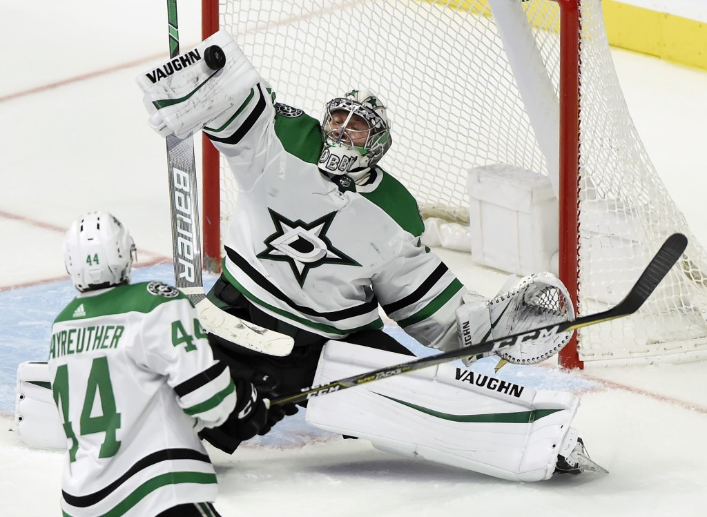 Dallas Stars goaltender Anton Khudobin (35), of Kazakhstan, deflects a Nashville Predators shot during the second period of an NHL hockey game Thursda...