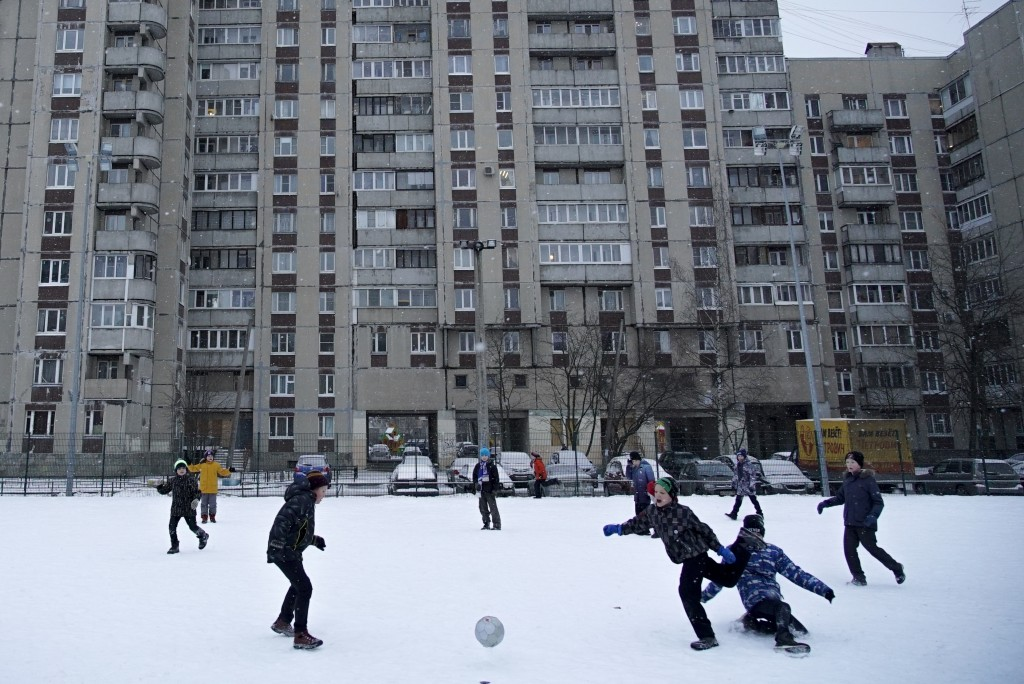 In this photo taken on Thursday, Dec. 20, 2018, students come play soccer at the stadium near the school building in St. Petersburg, Russia. Two Russi...