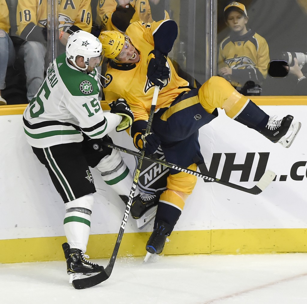 Dallas Stars left wing Blake Comeau, left, collides with Nashville Predators right wing Craig Smith during the third period of an NHL hockey game Thur...