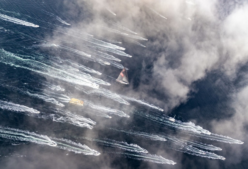 In this photo provided by Rolex/Studio Borlenghi, supermaxi Wild Oats XI, center, arrives in Hobart, Australia, to win the line honors in the Sydney H...