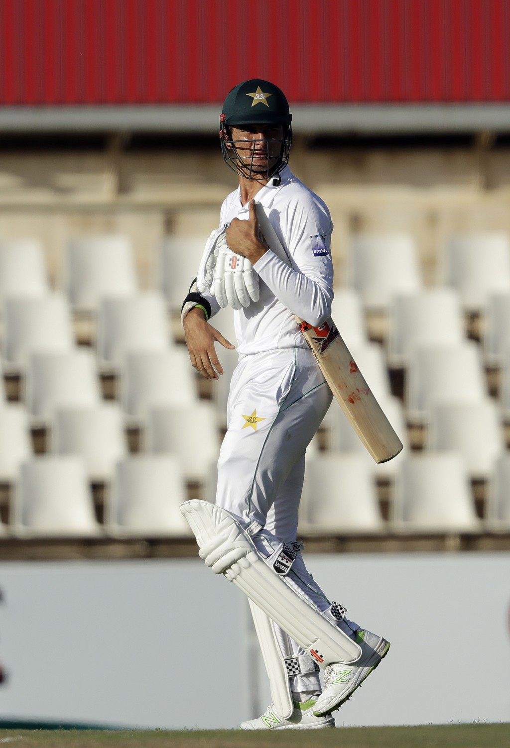 Pakistan's batsman Shaheen Afridi leaves the field after dismissed by South Africa's bowler Duanne Olivier for 4 runs on day two of the first cricket