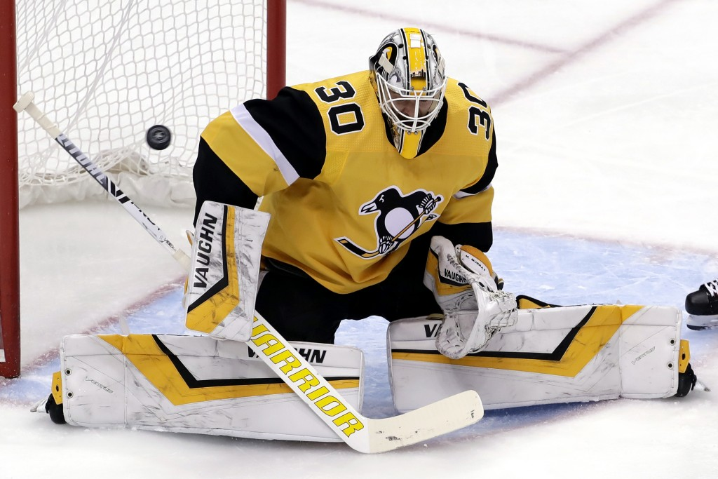 Pittsburgh Penguins goaltender Matt Murray blocks a shot during the first period of an NHL hockey game against the Detroit Red Wings in Pittsburgh, Th
