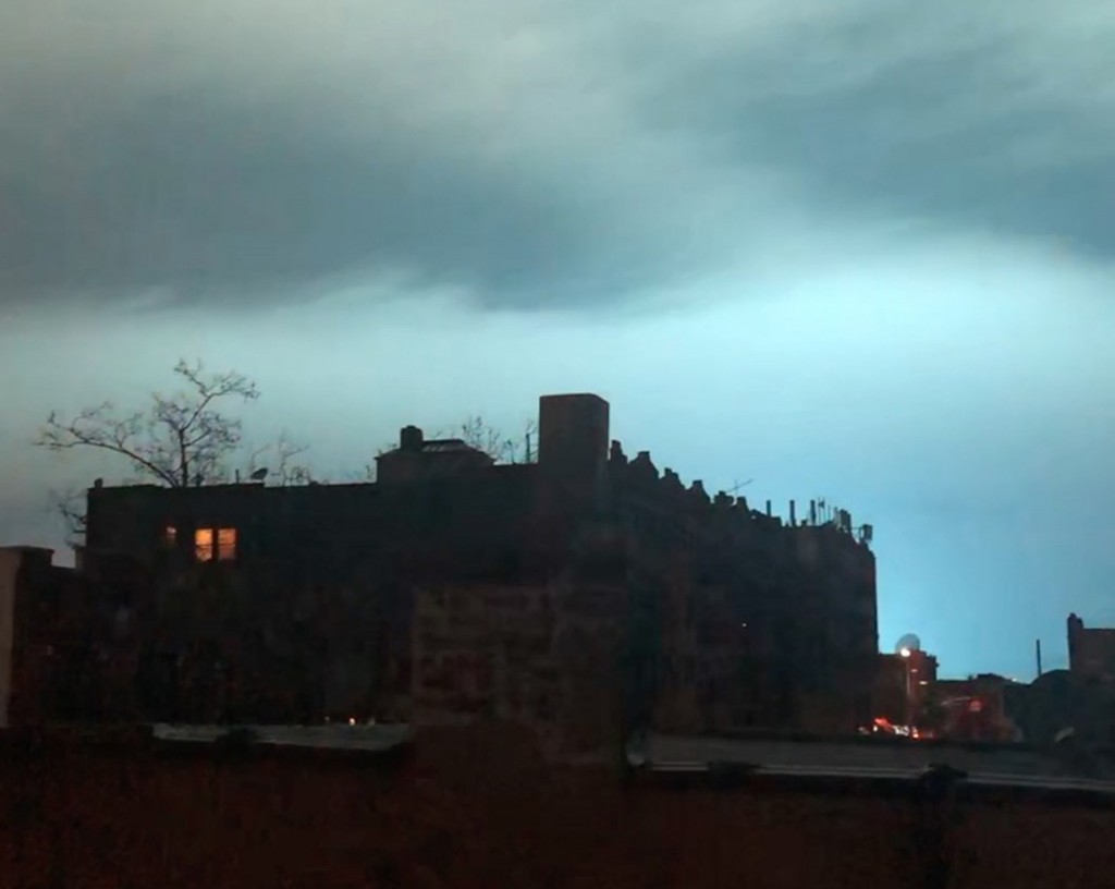 In this image taken from video, the night sky is illuminated in a bright, blue color after an explosion in the Queens borough of New York, Thursday, D...