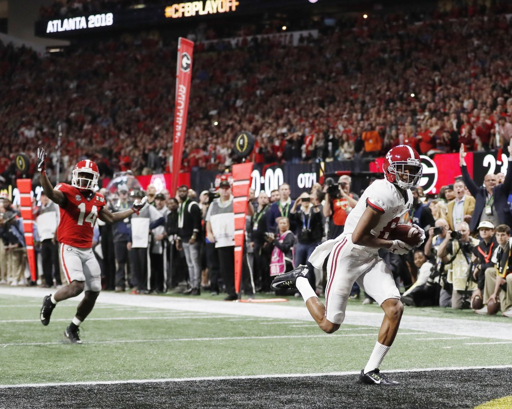 FILE - In this Jan. 8, 2018, file photo, Alabama wide receiver DeVonta Smith (6) makes a touchdown catch against Georgia during overtime of the NCAA c...