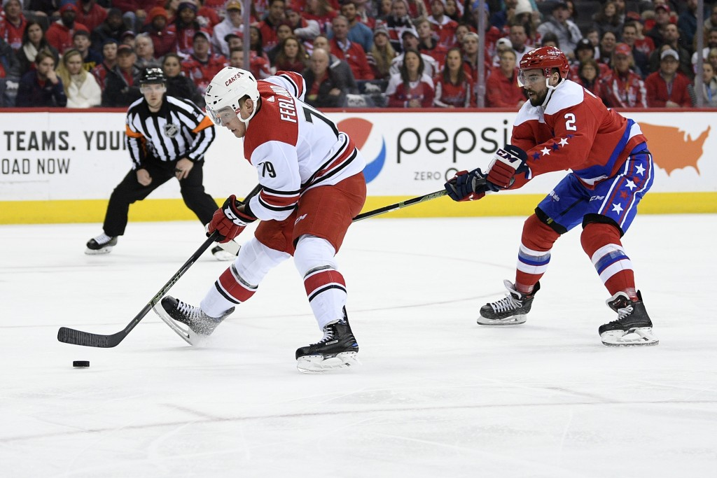 Carolina Hurricanes left wing Micheal Ferland (79) skates with the puck past Washington Capitals defenseman Matt Niskanen (2) during the first period