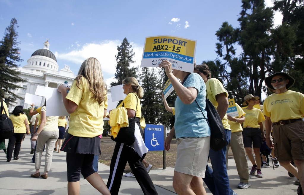 FILE - In this Sept. 24, 2015, file photo, supporters of a measure to allow terminally ill people to end their own life march at the Capitol in Sacram...