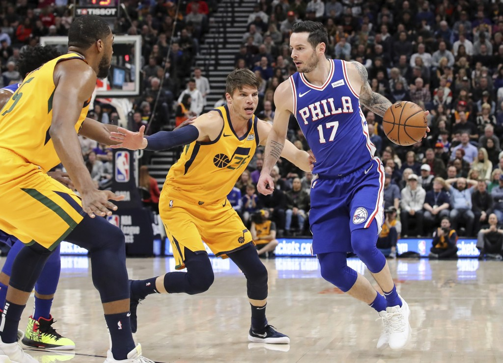 Philadelphia 76ers guard JJ Redick (17) is defended by Utah Jazz guard Kyle Korver (26) during the second quarter of an NBA basketball game Thursday, ...