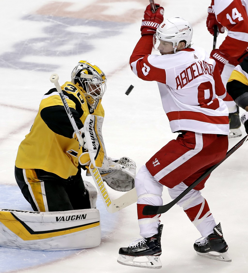 Pittsburgh Penguins goaltender Matt Murray (30) blocks a shot while being screened by Detroit Red Wings' Justin Abdelkader (8) during the first period...