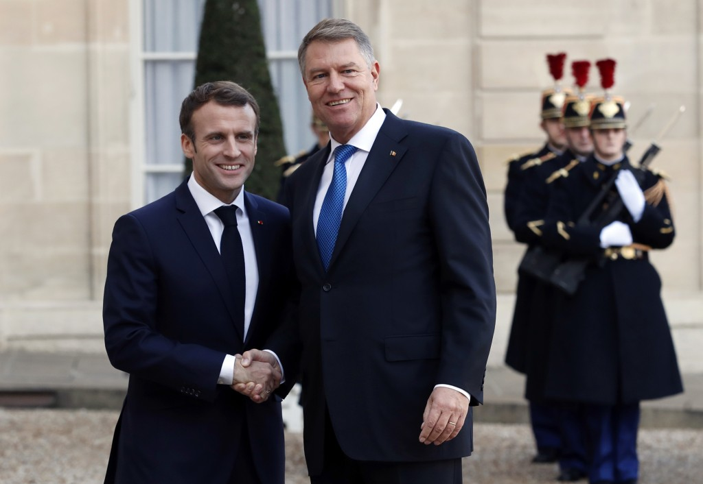 FILE - In this file photo dated Tuesday Nov. 27, 2018, French President Emmanuel Macron, left, greets Romanian President Klaus Iohannis at the Elysee
