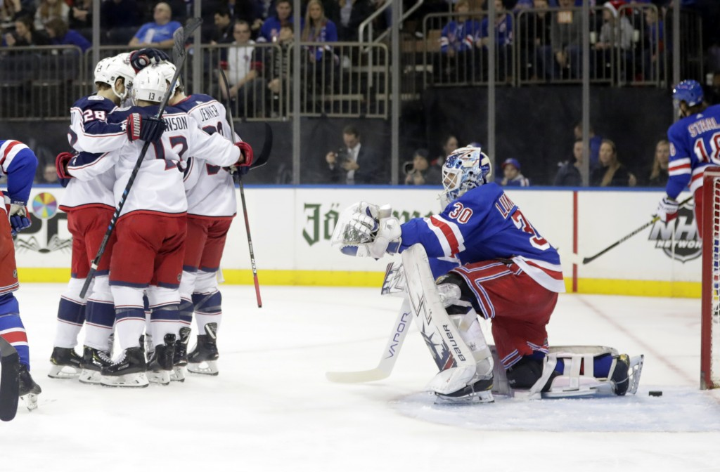 New York Rangers goaltender Henrik Lundqvist (30) watches as the Columbus Blue Jackets celebrate a goal by Oliver Bjorkstrand, left, during the first