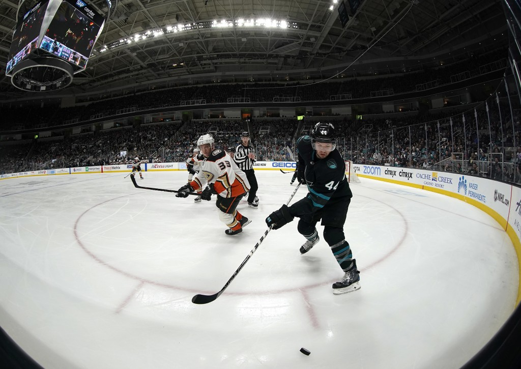 San Jose Sharks defenseman Marc-Edouard Vlasic (44) chases down the puck against Anaheim Ducks right wing Jakob Silfverberg (33) during the second per...